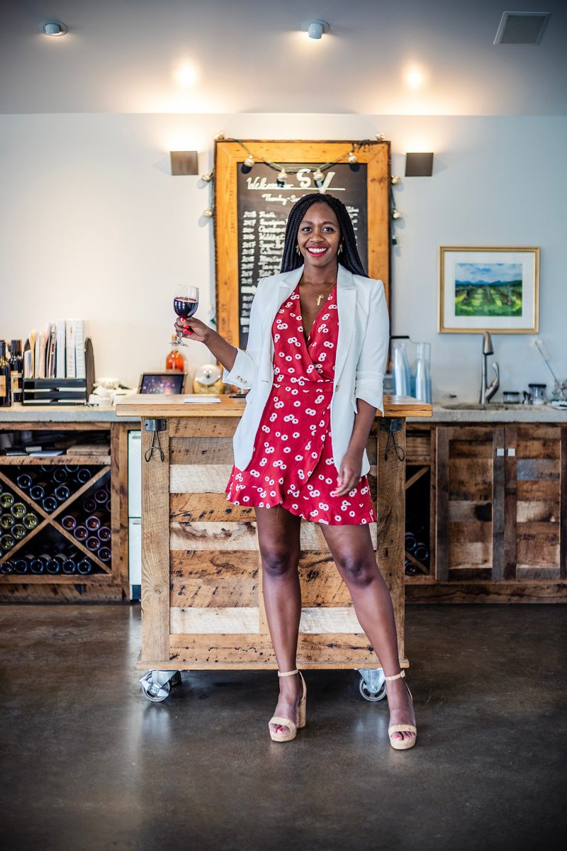 How to wear a floral romper for date night, featured by top US fashion blogger, Alicia Tenise: image of a woman wearing a LOFT white blazer, and a LOFT wrap floral romper