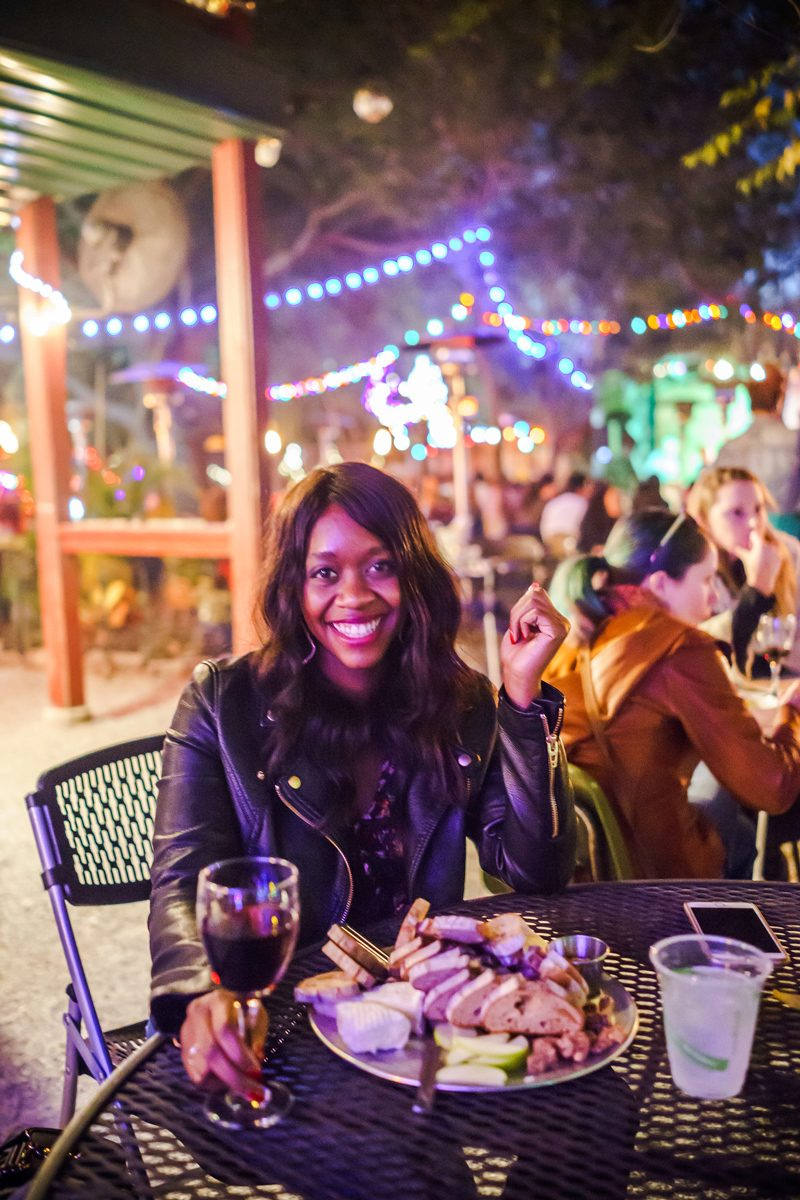 Top Things to Do in Bywater New Orleans featured by top US travel blogger, Alicia Tenise: have dinner at Bacchanal Wine New Orleans