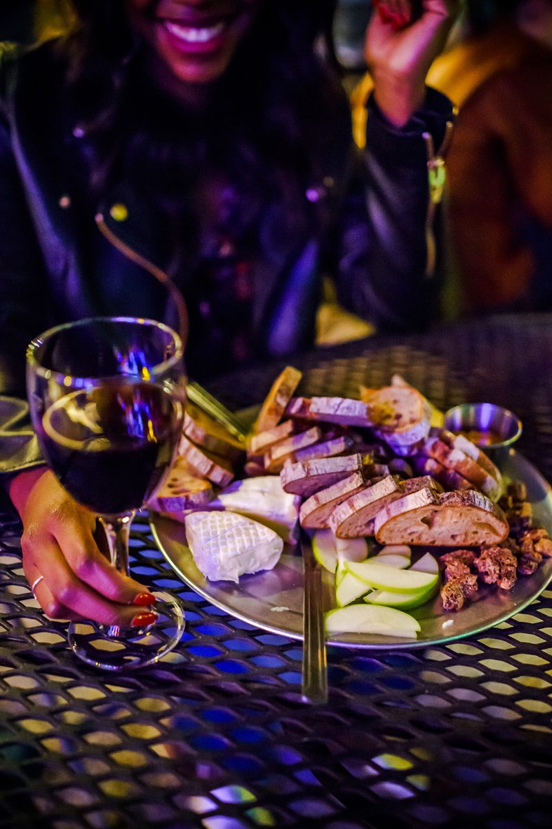 Top Things to Do in Bywater New Orleans featured by top US travel blogger, Alicia Tenise: have dinner at Bacchanal Wine New Orleans - image of Bacchanal Wine Cheese and Charcuterie Board