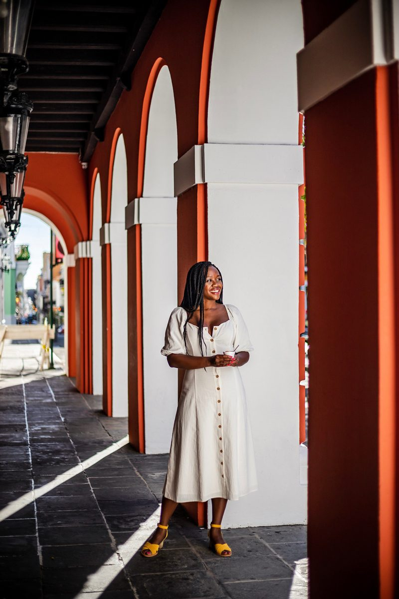 New Celebrity Summit review featured by top US travel blogger, Alicia Tenise: image of a woman wearing a White Linen Midi Dress for Summer, Puerto Rico
