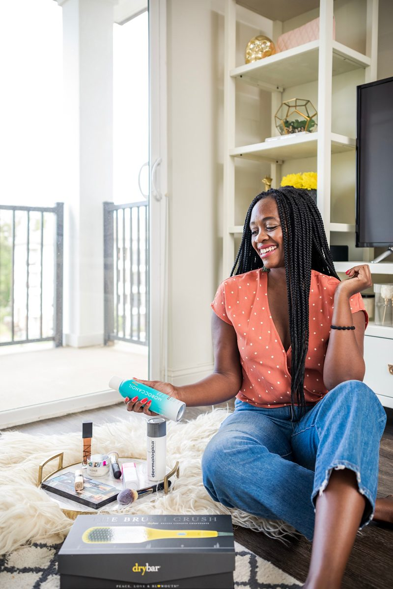 Sephora Beauty Insider Sale featured by top US beauty blogger Alicia Tenise; Image of a woman wearing polka dot top and jeans.