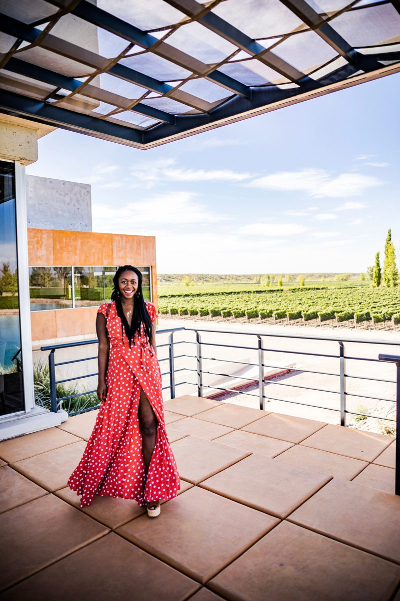 Mendoza Travel Guide featured by top US travel blogger Alicia Tenise; Image of a woman wearing a red polka dot dress.