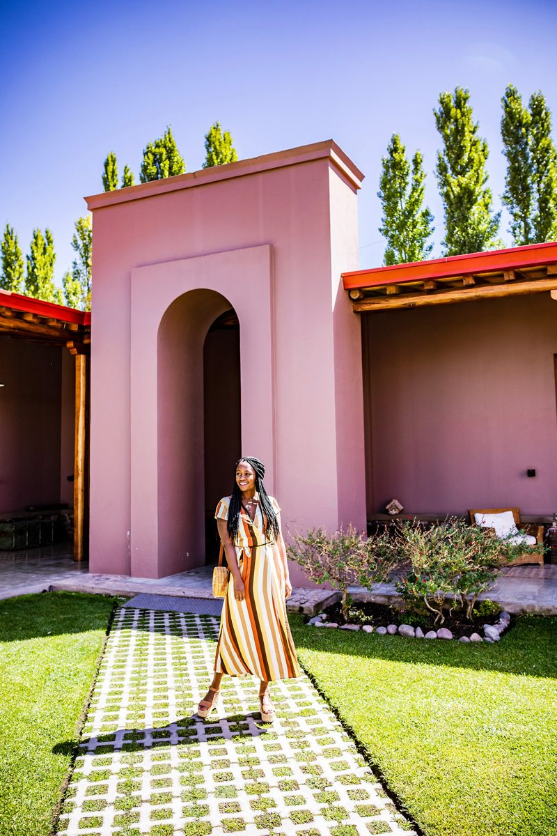 Mendoza Travel Guide featured by top US travel blogger Alicia Tenise; Image of a woman wearing striped dress.