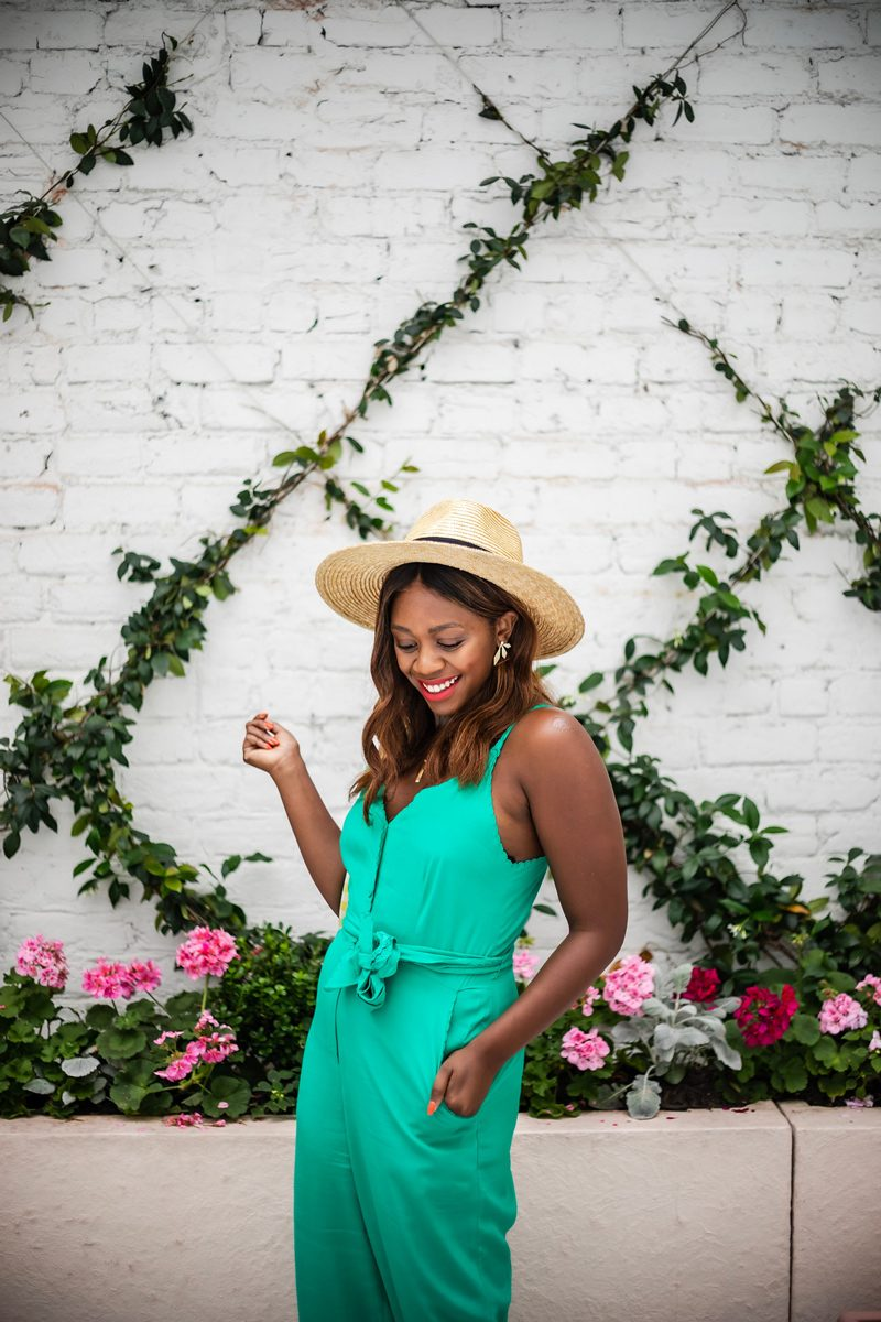 The Bloom Salon featured by top US beauty blogger Alicia Tenise; Image of a woman wearing a teal jumpsuit.