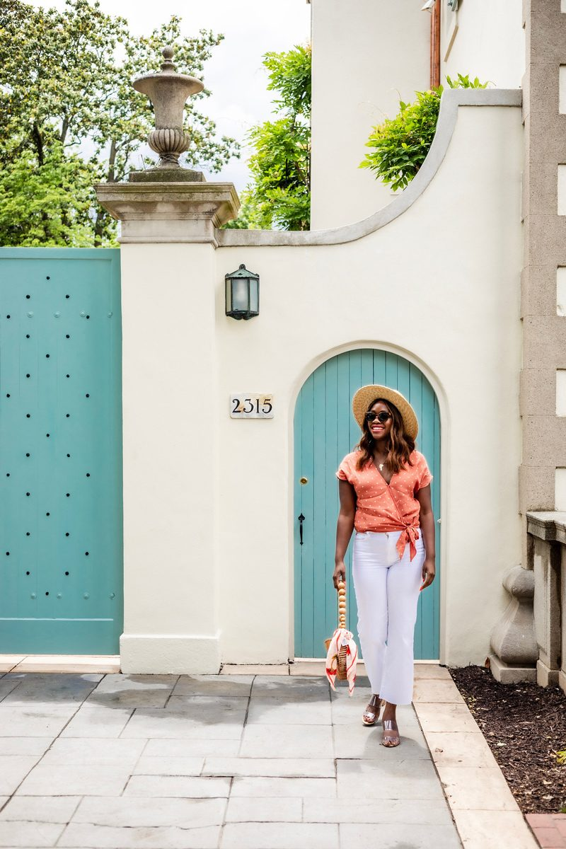 Squad Goals: Why I don't Have a Large Group of Friends by popular DC lifestyle blogger Alicia Tenise: image of woman standing outside a building with a turquoise door and wearing a Madewell Sash-Tie Wrap Top in Polka Dot, 7 For All Mankind Alexa High-Rise Cropped Wide-Leg Jeans, Schutz Victorie Slide Sandal, Cult Gaia Bamboo Circle Bag, Urban Outfitters sunglasses, Brixton Joanna Hat, Madewell Bandana, and Taudrey necklace.