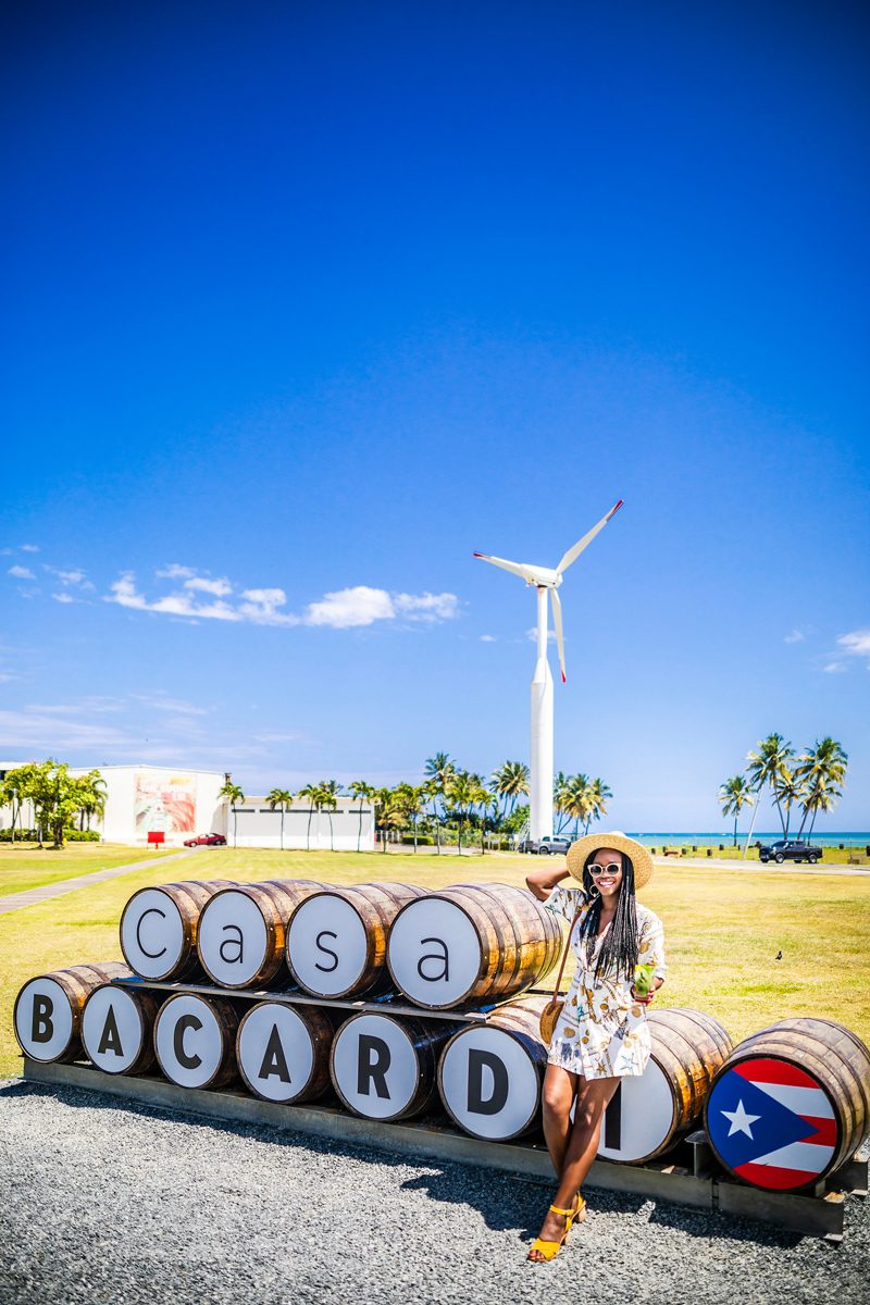 48 Hours in Old San Juan: A Travel Guide by popular Washington D.C. travel blogger, Alicia Tenise: image of a woman visiting Casa Bacardí Puerto Rico