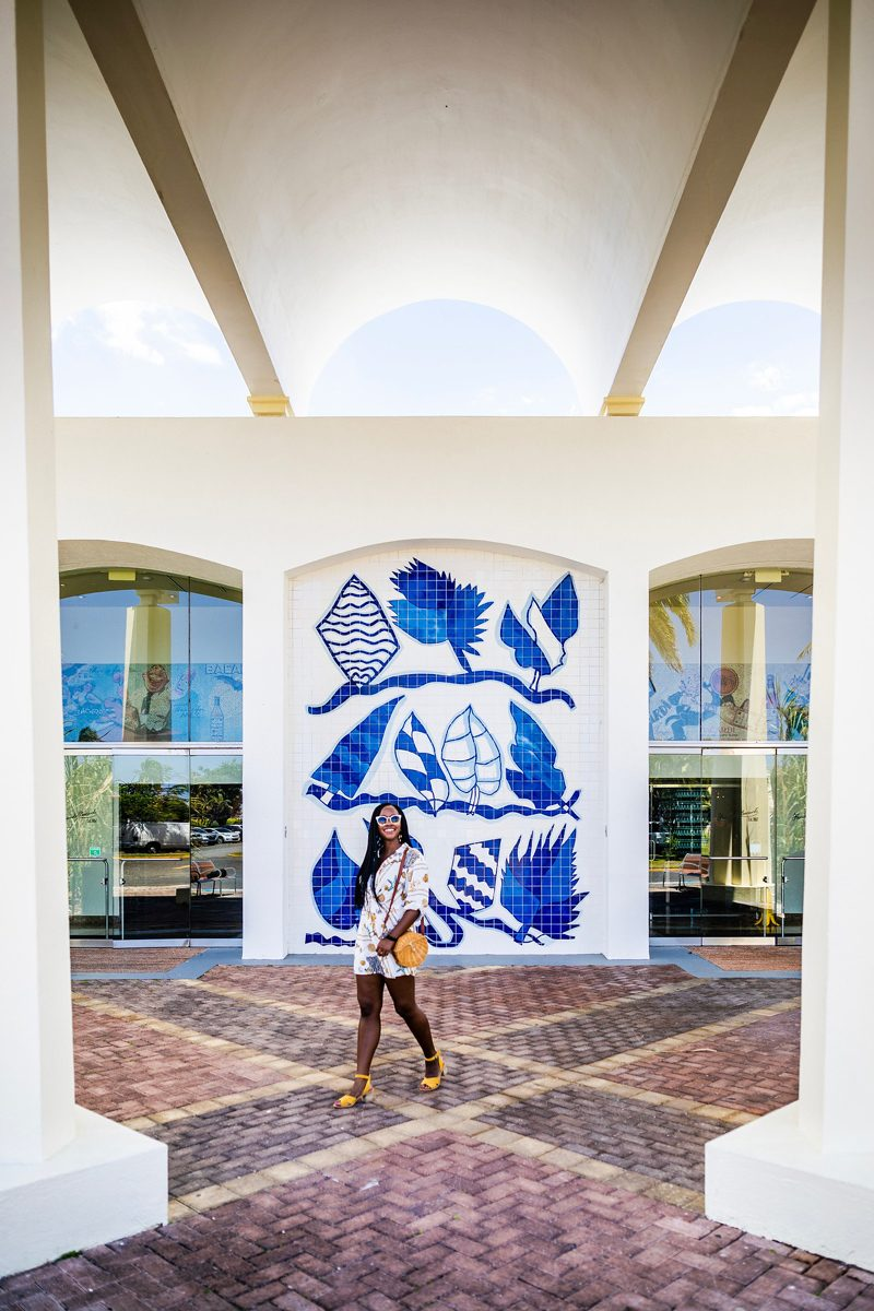 48 Hours in Old San Juan: A Travel Guide by popular Washington D.C. travel blogger, Alicia Tenise: image of a woman standing in front of Casa Bacardí Puerto Rico