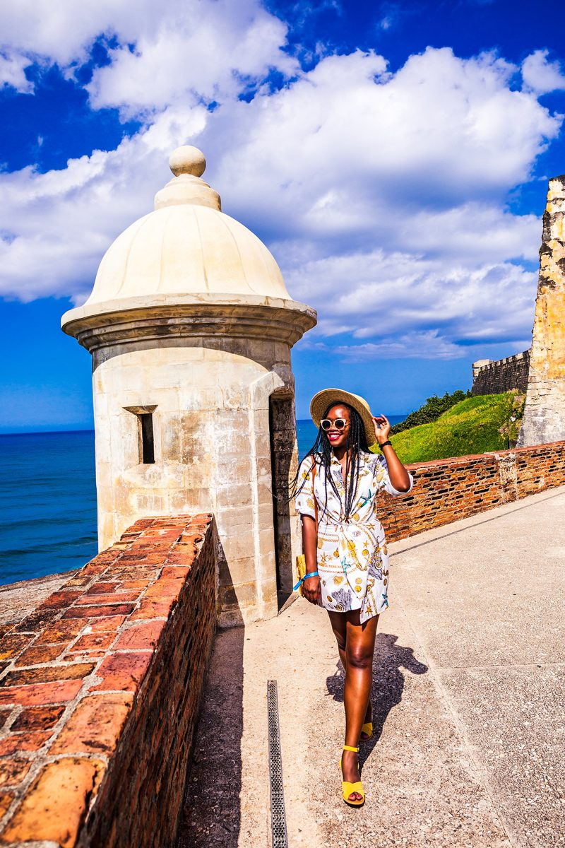48 Hours in Old San Juan: A Travel Guide by popular Washington D.C. travel blogger, Alicia Tenise: image of a woman visiting Forts in Old San Juan