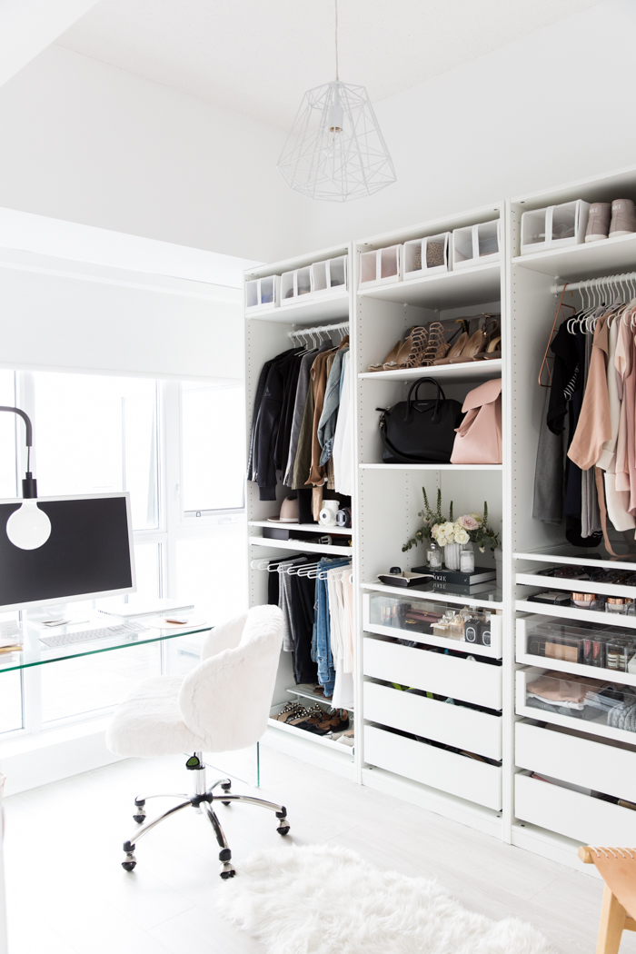 New Home Decor Ideas by popular Washington D.C. life and style blogger, Alicia Tenise: image of a Cloffice with white shelving, glass computer table, white swivel chair, white sheep skin rug,