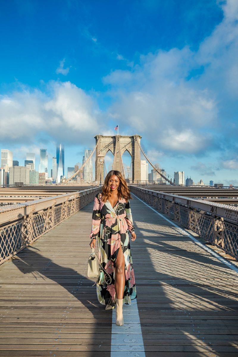 Why I Didn't Travel That Much This Summer + My Fall Travel Bucket List Plans by popular Washington D.C. travel blogger, Alicia Tenise: image of a woman walking down the Brooklyn Bridge.