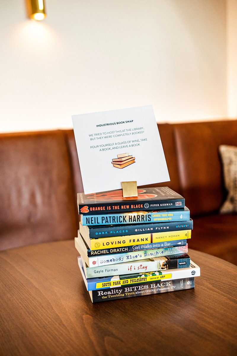My Office Tour at Industrious Alexandria, VA by popular DC blogger, Alicia Tenise: image of a stack of books