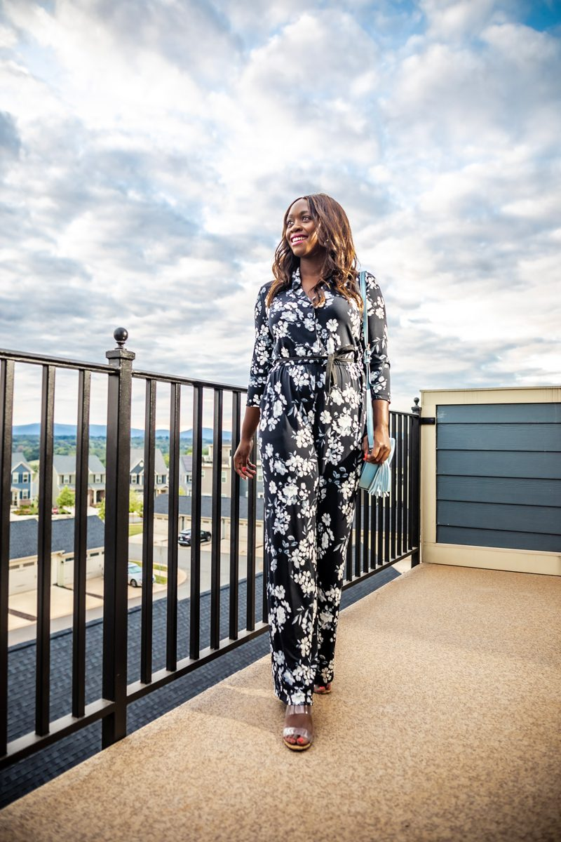 Calvin Klein Three-Quarter Floral Tie Waist Jumpsuit | Summer to Fall Looks: Two Transitional Outfit Ideas Under $100 by popular Washington D.C. fashion blogger, Alicia Tenise: image of a woman standing outside and wearing a Walmart Calvin Klein  Three-Quarter Floral Tie Waist Jumpsuit and Metallic Sky Circle Crossbody.