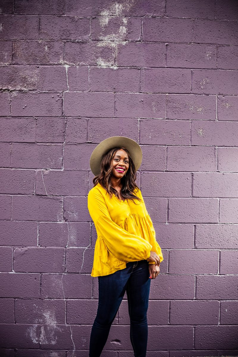 Time and Tru Women's Ruffle Edge Peasant Top | Summer to Fall Looks: Two Transitional Outfit Ideas Under $100 by popular Washington D.C. fashion blogger, Alicia Tenise: image of a woman standing in front of a purple brick wall and wearing a Walmart Time and Tru  Women's Ruffle Edge Peasant Top, Walmart Time and Tru  Time and Tru Women's Sculpted Jegging, and Walmart   Classic Vintage Winter Wide Brim Fedora Hat 961SH Image 1 of 1  Tell us if something is incorrect Pop Fashionwear  Classic Vintage Winter Wide Brim Fedora Hat.