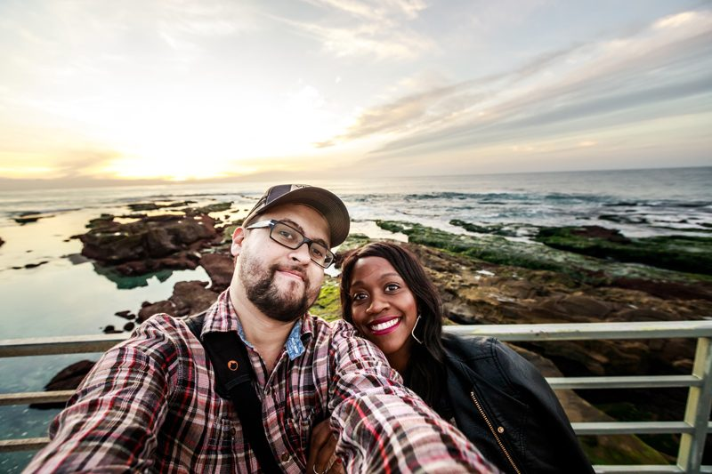 Tom's Travel Photography Tips: How to Nail the Perfect Shot While Traveling by popular travel blogger, Alicia Tenise: image of a man and a woman standing together.