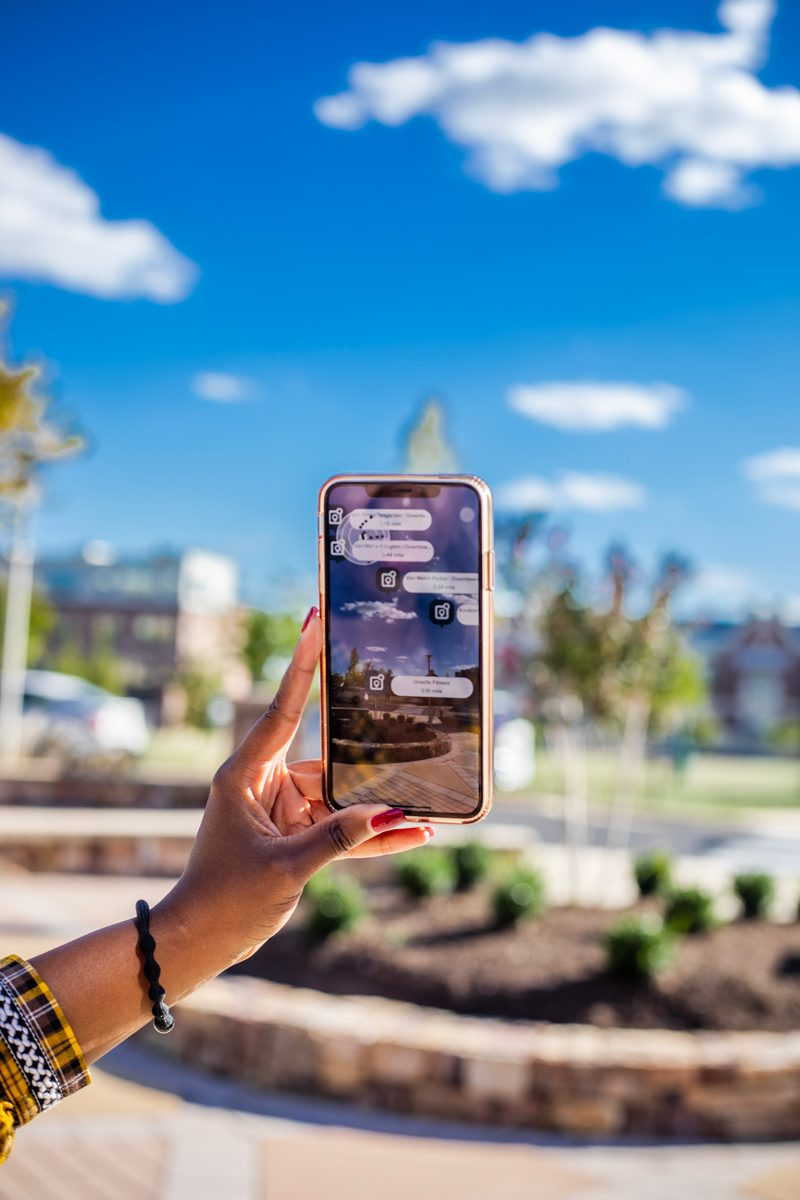 Brambleton VA: The Tech-Savvy Town That Needs to Be On Your Radar by popular life and style blogger, Alicia Tenise: image of a woman looking at the Brambleton app on her phone.