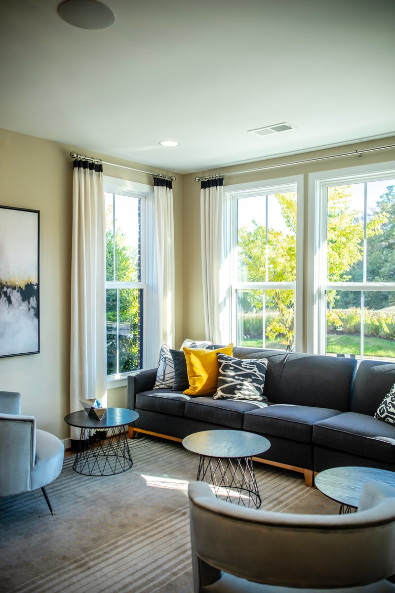 Brambleton VA: The Tech-Savvy Town That Needs to Be On Your Radar by popular life and style blogger, Alicia Tenise: image of a sitting room in a town house.