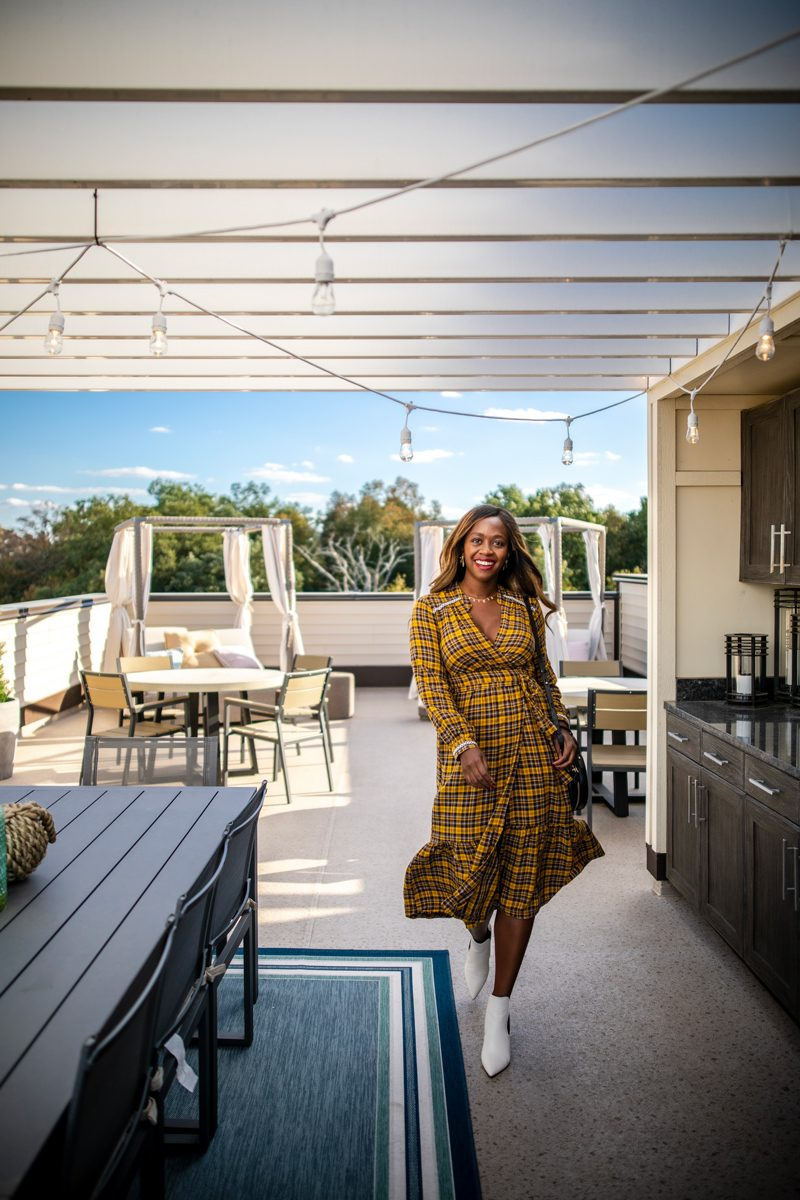 Brambleton VA: The Tech-Savvy Town That Needs to Be On Your Radar by popular life and style blogger, Alicia Tenise: image of a woman in an outdoor living space.