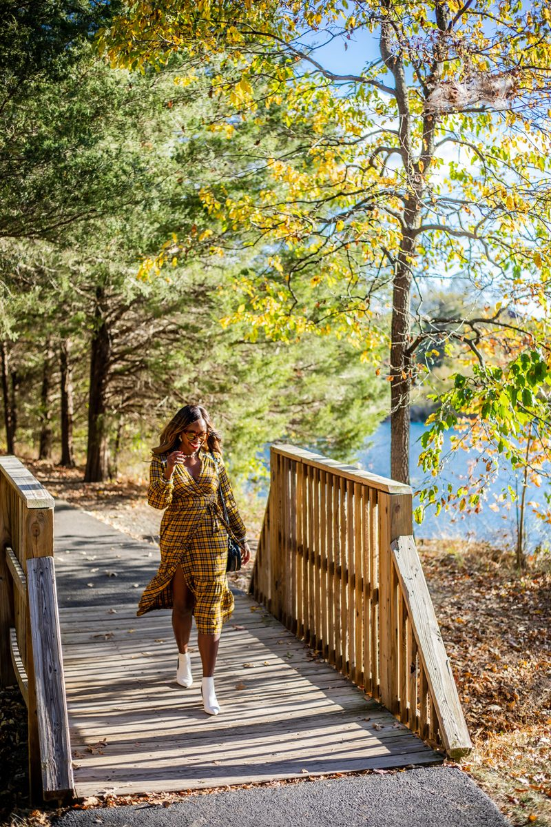 Brambleton VA: The Tech-Savvy Town That Needs to Be On Your Radar by popular life and style blogger, Alicia Tenise: image of a woman walking across a small foot bridge.