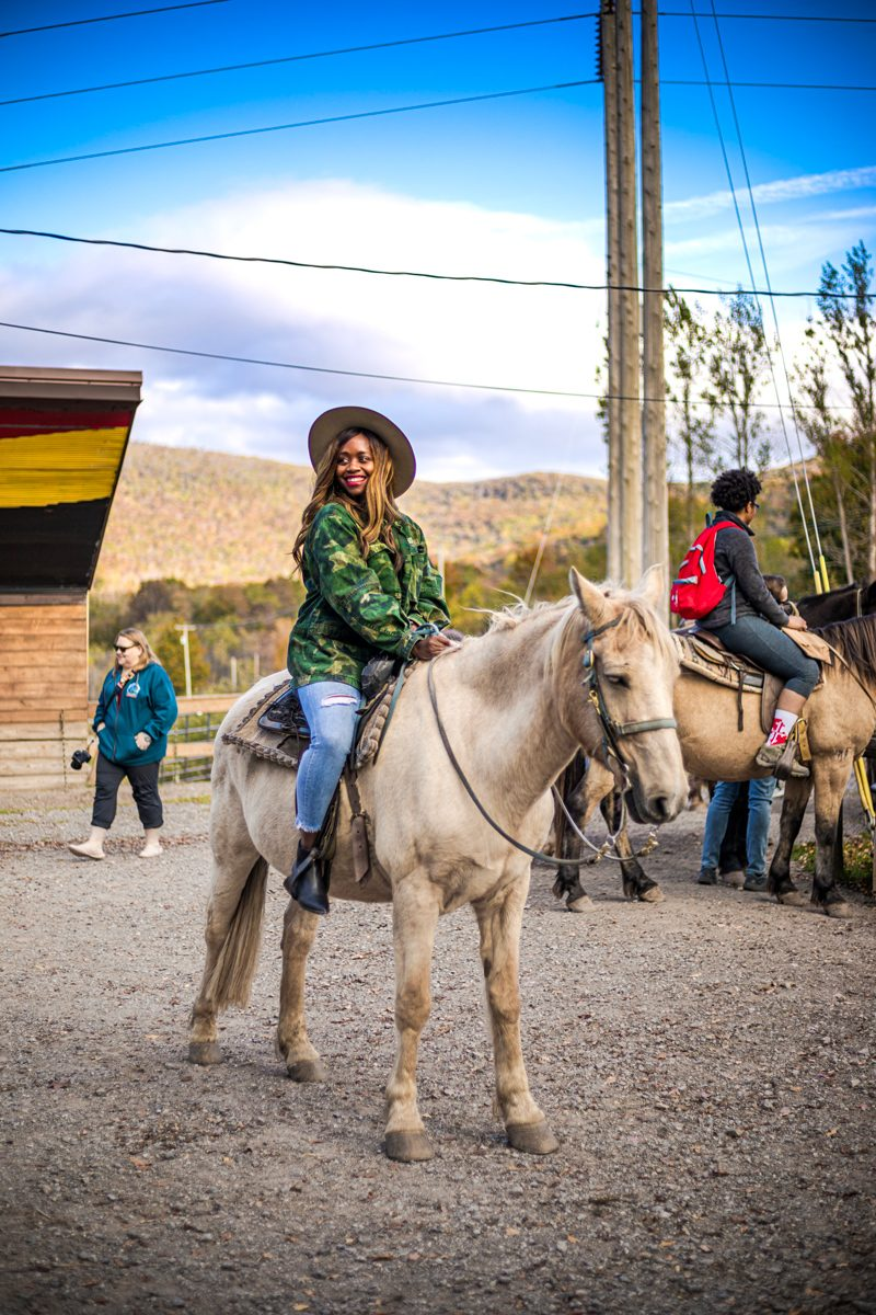 Fall Foliage by D.C. travel blogger, Alicia Tenise: image of Alicia Tenise riding a horse.