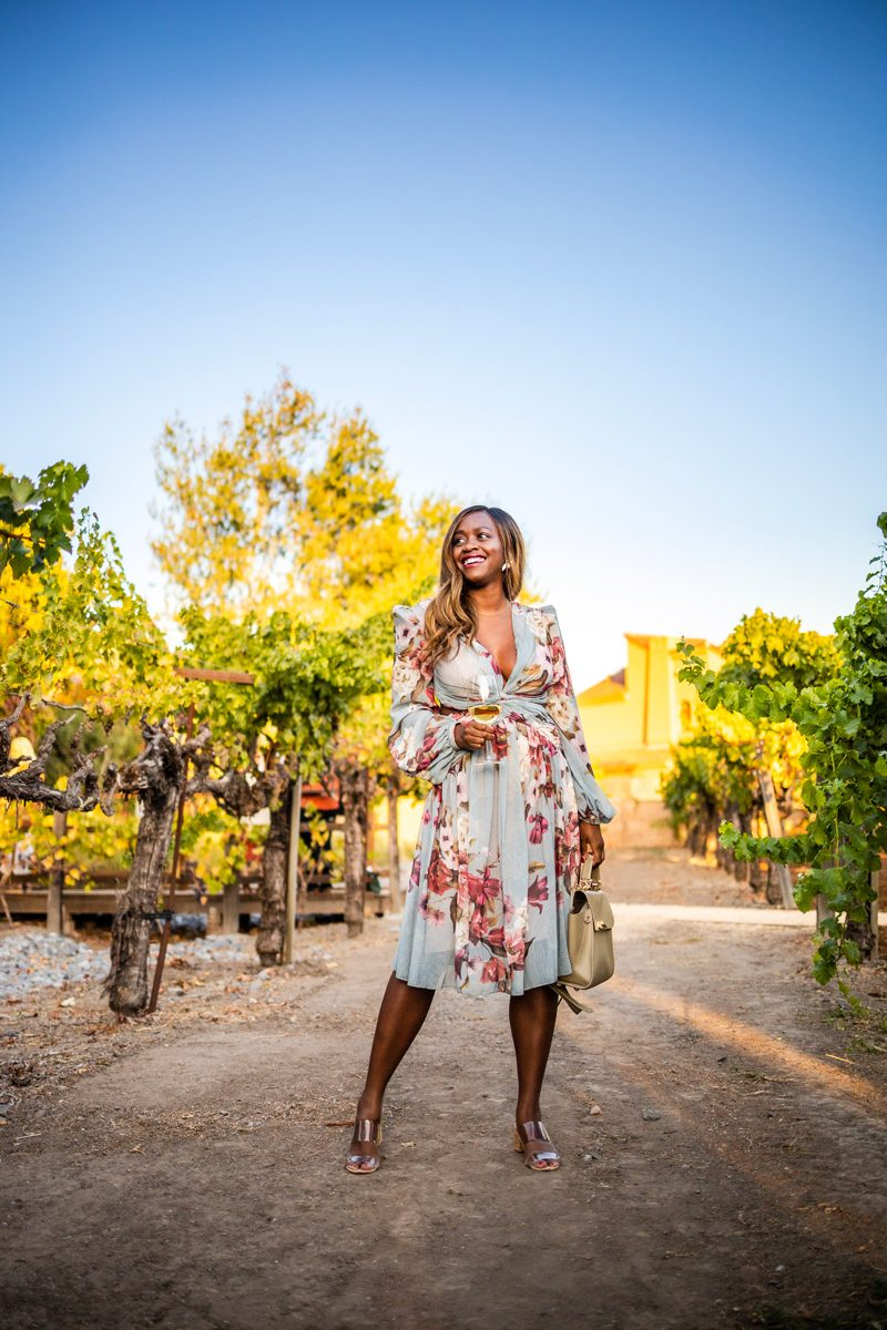 Vintners Resort review featured by top US travel blogger, Alicia Tenise: image of a woman wearing PATBO PEONY PRINT CUTOUT DRESS, Vintners Resort