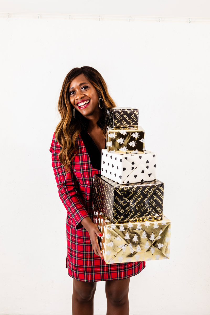 Rent the Runway Holiday Style Favorites featured by top US fashion blogger, Alicia Tenise: image of a woman wearing a Sail to Sable Red Plaid Tunic Dress