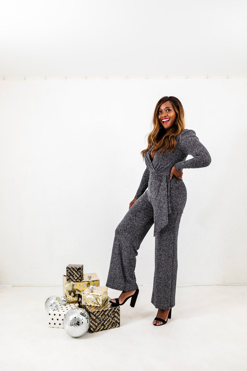 Rent the Runway Holiday Style Favorites featured by top US fashion blogger, Alicia Tenise: image of a woman wearing a Jonathan Simkhai Black Glitter Jumpsuit