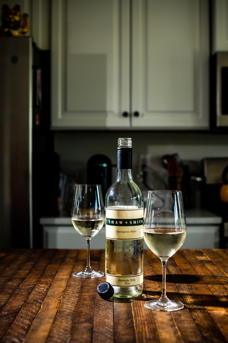 The Best Wines for Thanksgiving Dinner by popular Washington D.C. lifestyle blogger, Alicia Tenise: image of two wine glasses and a bottle of Shaw and Smith Savignon Blanc wine.