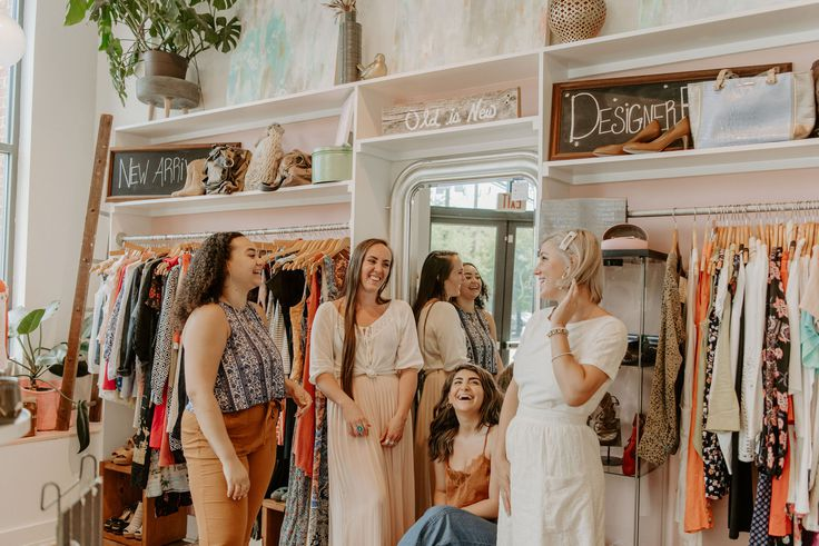 Darling Boutique Charlottesville Virginia | Top Women Owned Small Businesses to Support This Holiday Season by popular Washington D.C. life and style blogger, Alicia Tenise: image of women standing inside Darling Boutique.