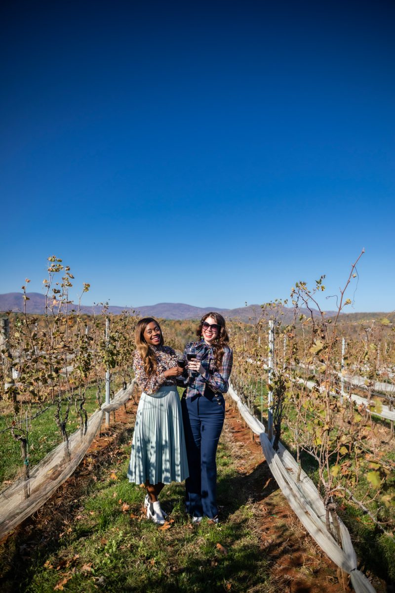 I Don't Fit In the Influencer Industry (And It's OK) by popular Washington DC life and style blogger, Alicia Tenise: image of a woman standing in a vineyard with her friend and wearing a Nordstrom Halogen x Atlantic-Pacific Pleated Croc Faux Leather Midi Skirt and Zappos Marc Fisher LTD Taci.