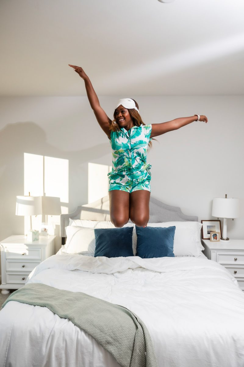 Soma Palm Print Cool Nights Pajamas, Leesa Mattress | Five Ways to Get a Good Night Sleep by popular D.C. life and style blogger, Alicia Tenise: image of a woman jumping on her bed.