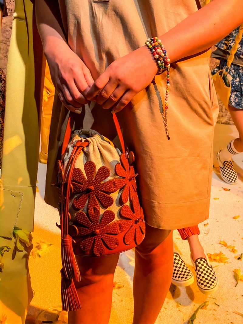 Rebecca Minkoff Spring 2020 Presentation | NYFW 2020 by popular DC fashion blogger, Alicia Tenise: image of a model holding a Rebecca Minkoff bag.