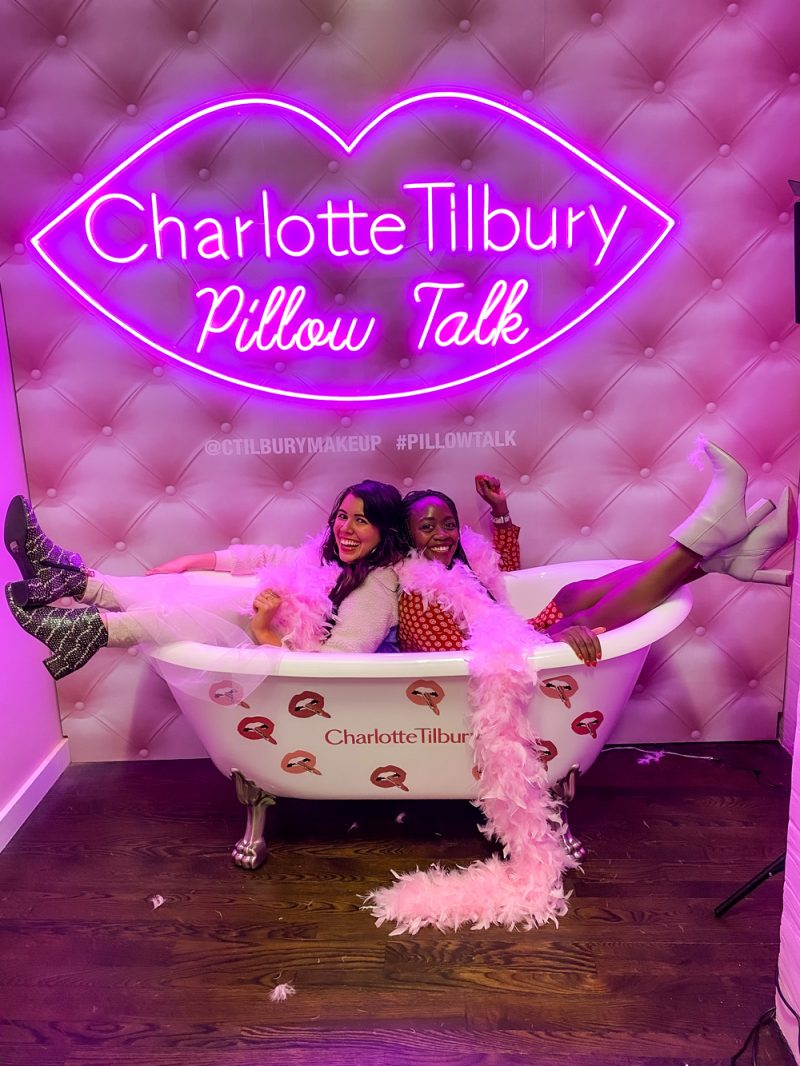 Charlotte Tilbury Showroom | NYFW 2020 by popular DC fashion blogger, Alicia Tenise: image of two women sitting in a tub at the Charlotte Tilbury Pillow Talk showroom.