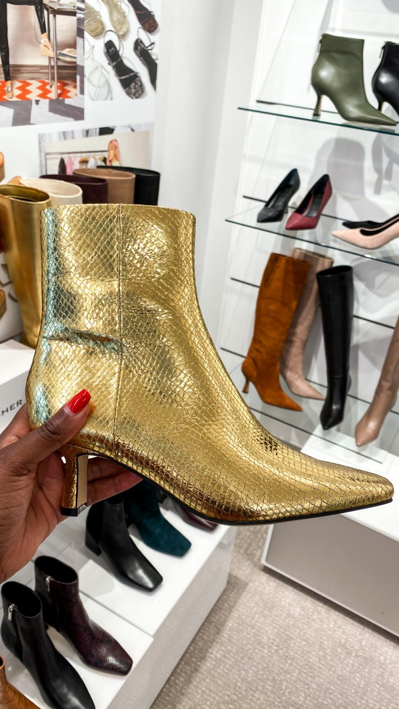 Marc Fisher Fall 2020 - Metallic Boot Trend | NYFW 2020 by popular DC fashion blogger, Alicia Tenise: image of a woman holding a gold metallic Marc Fisher boot.