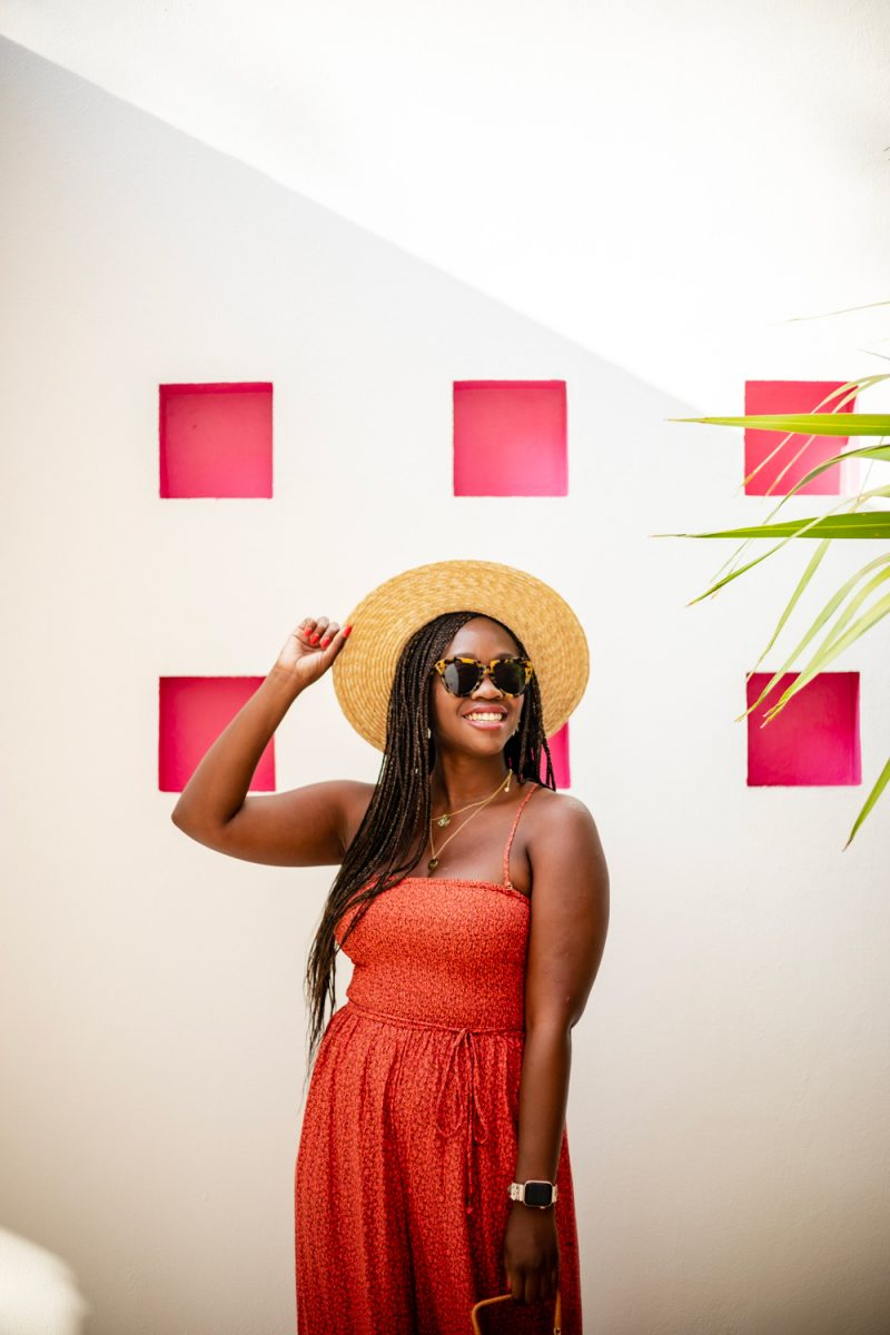 Karen Walker Number One Sunglasses in Crazy Tort    How to Deal with Stress and Anxiety by popular DC lifestyle blogger, Alicia Tenise: image of a woman wearing a ShopBop Free People Free People Little Of Your Love Jumpsuit, Nordstrom Brixton Joanna Straw Hat, ShopBop Karen Walker The Number One Sunglasses, and holding a Moda Operandi Cult Gaia bag.