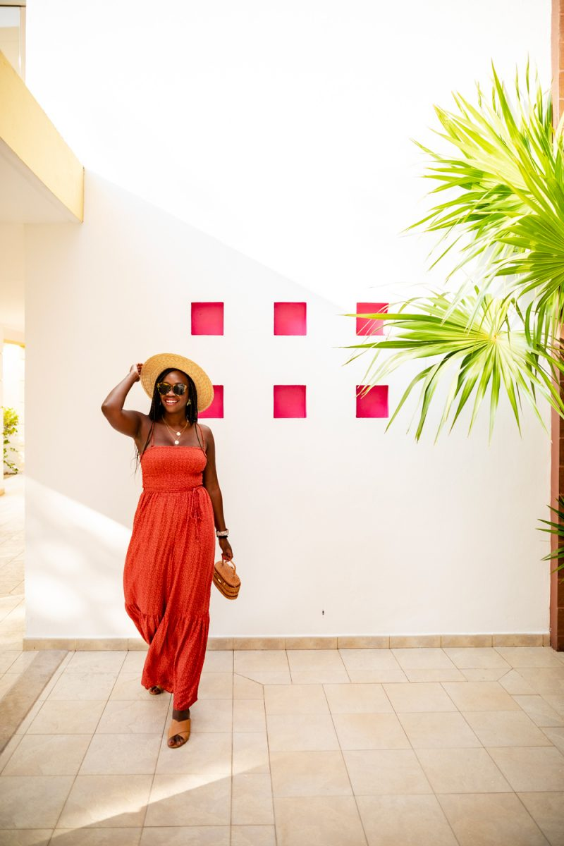 How to Deal with Stress and Anxiety by popular DC lifestyle blogger, Alicia Tenise: image of a woman wearing a ShopBop Free People Free People Little Of Your Love Jumpsuit, Nordstrom Brixton Joanna Straw Hat, ShopBop Karen Walker The Number One Sunglasses, and holding a Moda Operandi Cult Gaia bag.