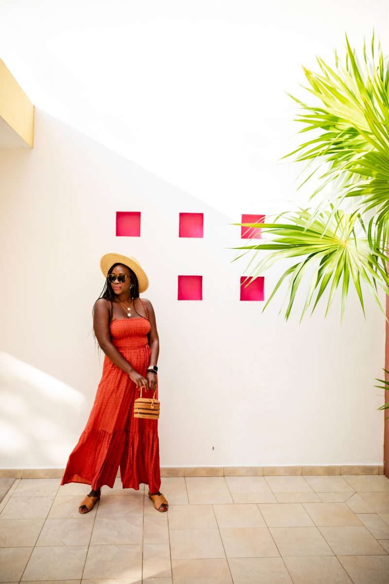 Free People Little Of Your Love Jumpsuit |  How to Deal with Stress and Anxiety by popular DC lifestyle blogger, Alicia Tenise: image of a woman wearing a ShopBop Free People Free People Little Of Your Love Jumpsuit, Nordstrom Brixton Joanna Straw Hat, ShopBop Karen Walker The Number One Sunglasses, and holding a Moda Operandi Cult Gaia bag.