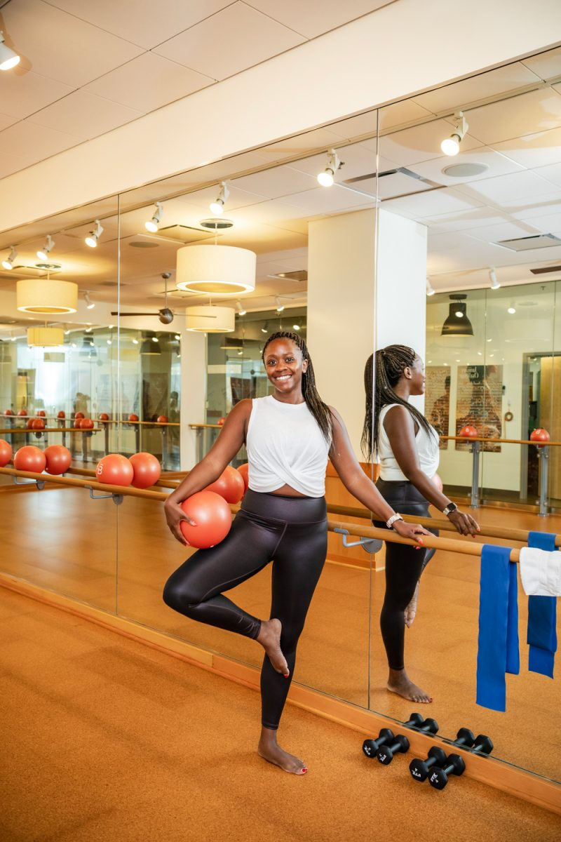 barre3 DC | Best Workout Classes in DC by popular DC lifestyle blogger, Alicia Tenise: image of a woman at Orange Theory.