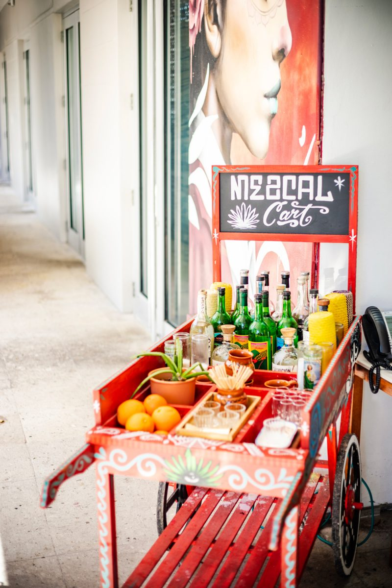 Things to do in Miami in the Spring: image of a bar red bar cart.