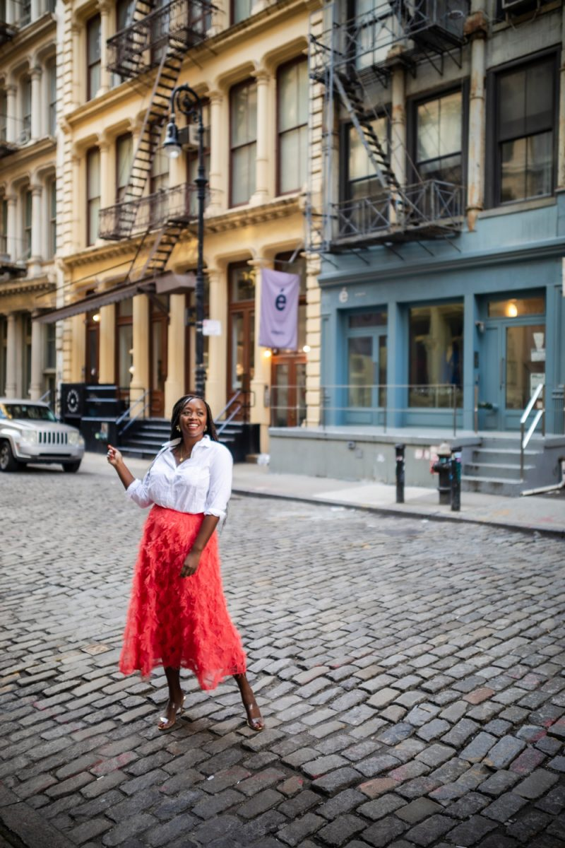 NYFW 2020 by popular DC fashion blogger, Alicia Tenise: image of a woman standing on a cobblestone street and wearing a Anthropologie Cynthia Textured A-Line Midi Skirt, Nordstrom The Hero Washed Cotton Shirt GRAYSON, and Revolve Ariella Heel  Schutz brand: Schutz.