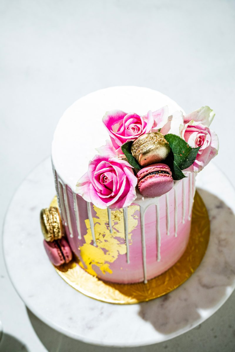 Pink and Gold Birthday Cake Maliha Creations | Turning 30 by popular lifestyle blogger, Alicia Tenise: image of a Maliha Creations cake on a Target Marble & Acacia Cake Stand.
