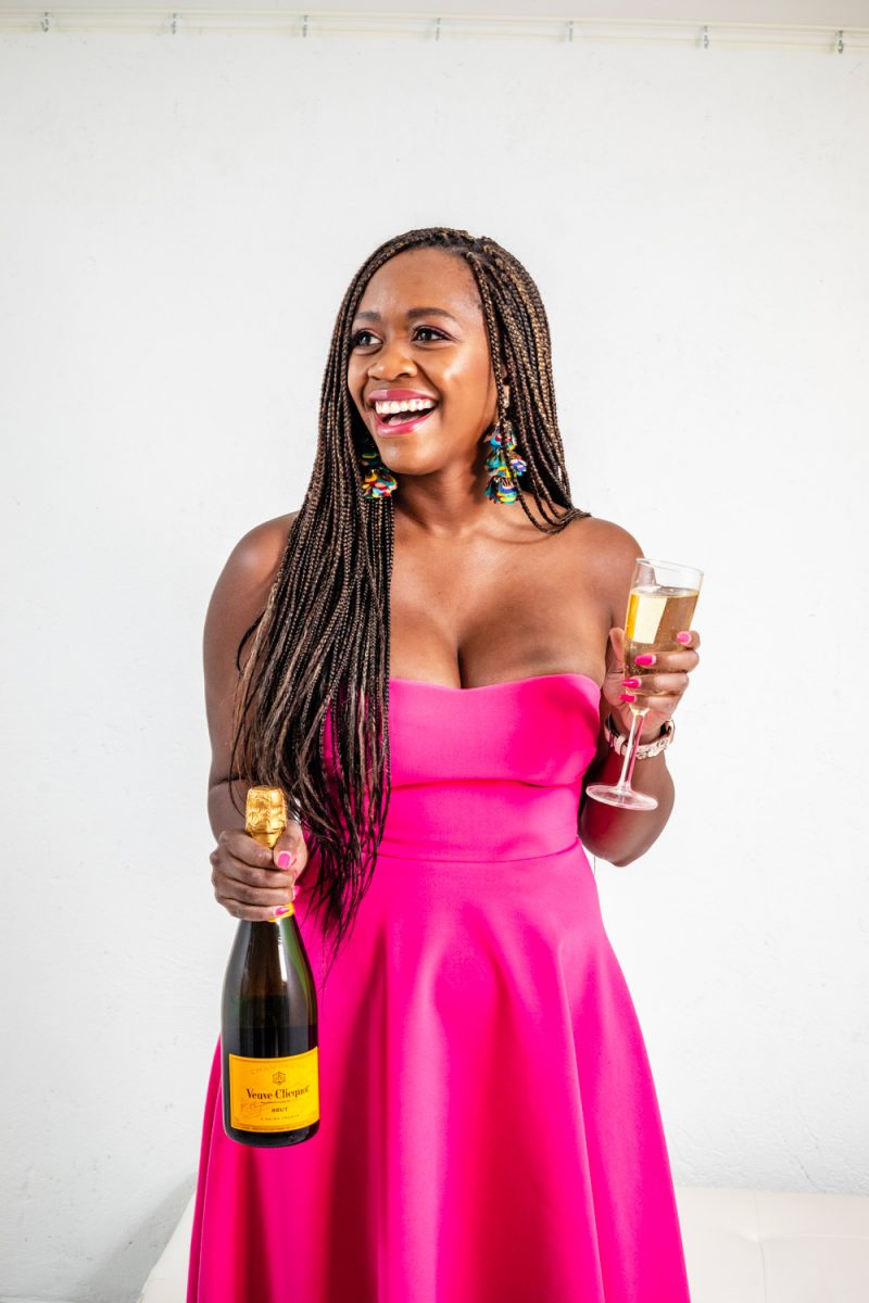 Likely High Low Lovelle Gown | Turning 30 by popular lifestyle blogger, Alicia Tenise: image of a woman wearing a Rent the Runway LIKELY ADD TO HEARTS High Low Lovelle Gown and holding a bottle and glass of champagne.