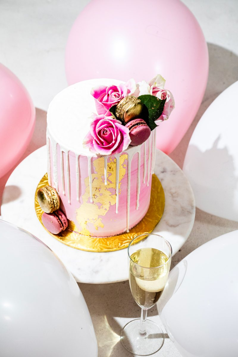 Maliha Creations Pink and Gold Birthday Cake | Turning 30 by popular lifestyle blogger, Alicia Tenise: image of a Maliha Creations cake on a Target Marble & Acacia Cake Stand.