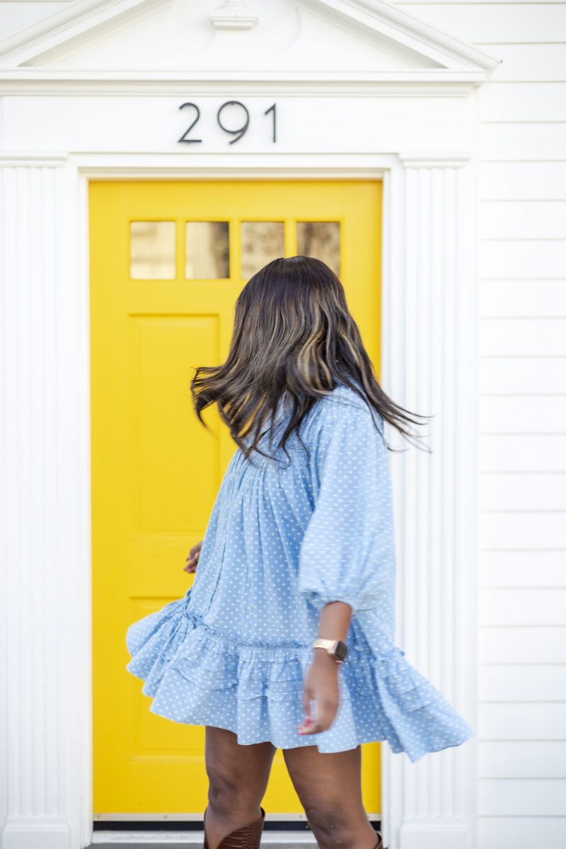 Shopbop Sale featured by top US fashion blogger Alicia Tenise; Image of a woman wearing the Free People Lets Be Friends Midi Dress   ShopBop Sale by popular DC fashion blogger, Alicia Tenise: image of a woman standing outside a blue brick building and wearing a ShopBop Free People Full Swing Dress.