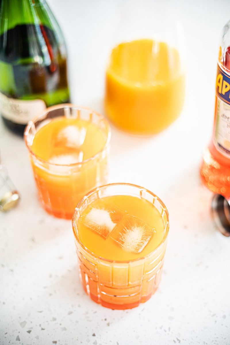 Aperol Tangerine Mimosa, Warm Weather Cocktail Ideas |Aperol Tangerine Mimosa by popular D.C. lifestyle blogger, Alicia Tenise: image of a Aperol Tangerine Mimosa.