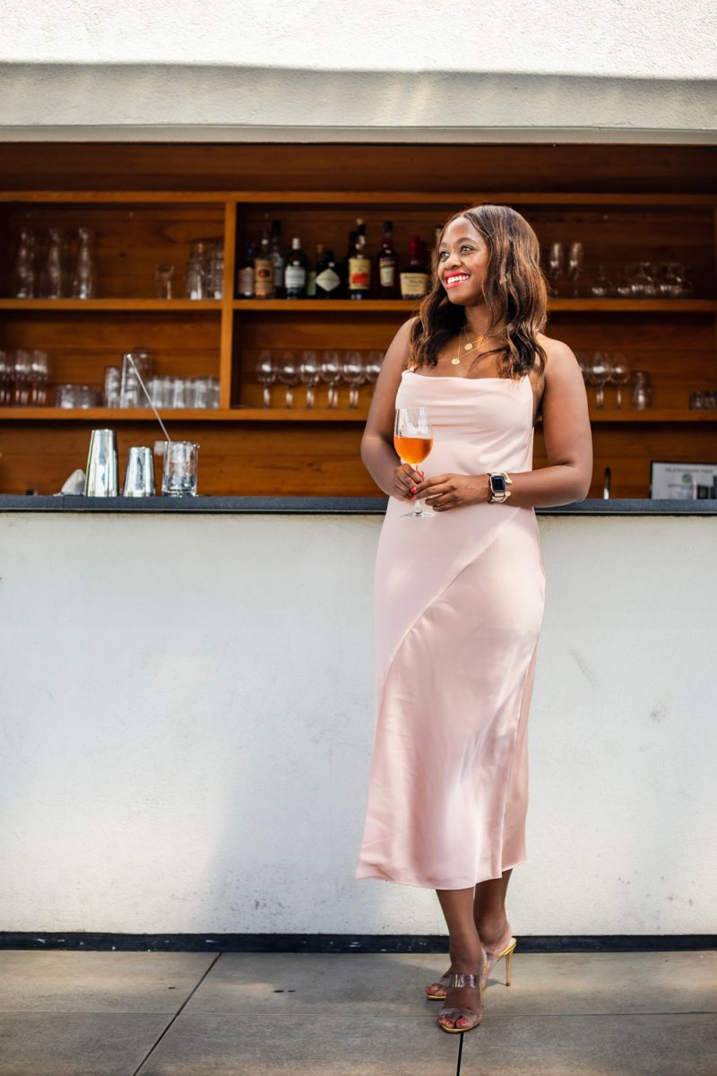 Women's Slip Dress - CUSHNIE for Target (Regular & Plus) Blush Pink | Black Owned Fashion Brands by popular D.C. fashion blogger, Alicia Tenise: image of Alicia Tenise standing at a bar and wearing a target Cushnie dress.