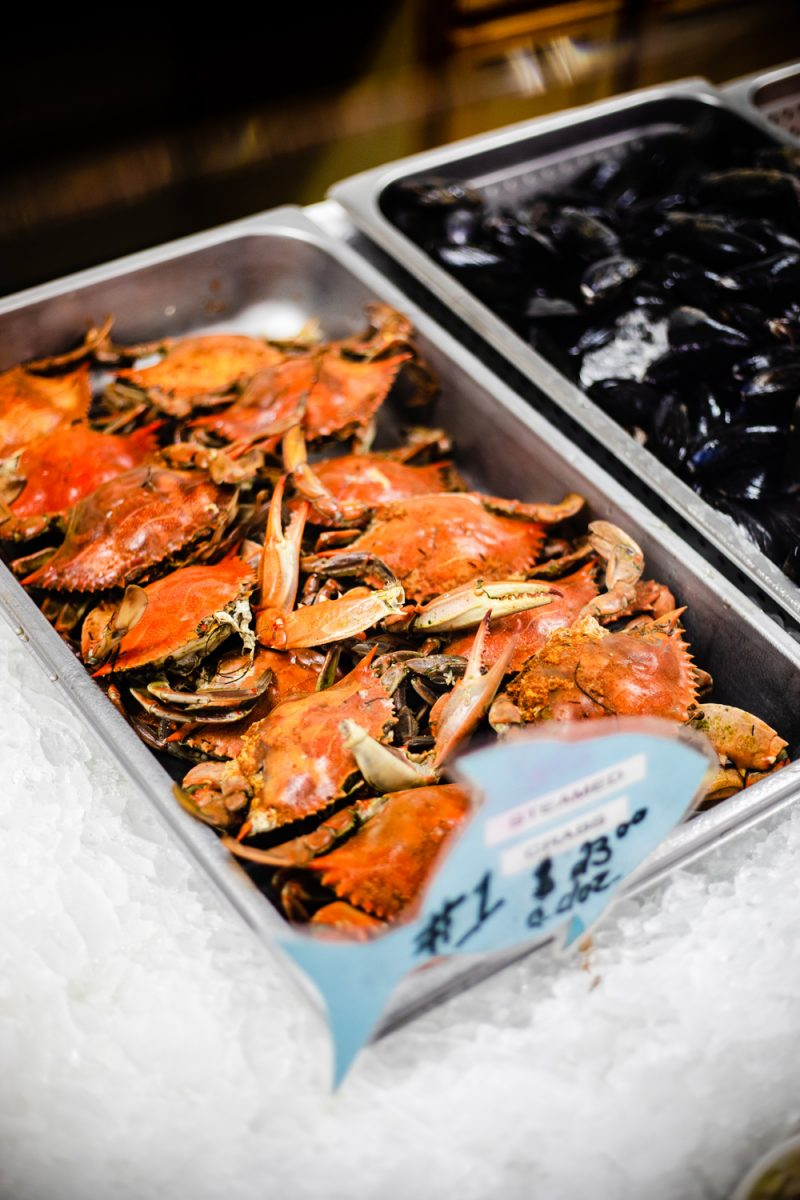 The Landing Grill at the Wanchese Marina | Things to do in the Outer Banks by popular D.C. travel blogger, Alicia Tenise: image of red crabs on ice.