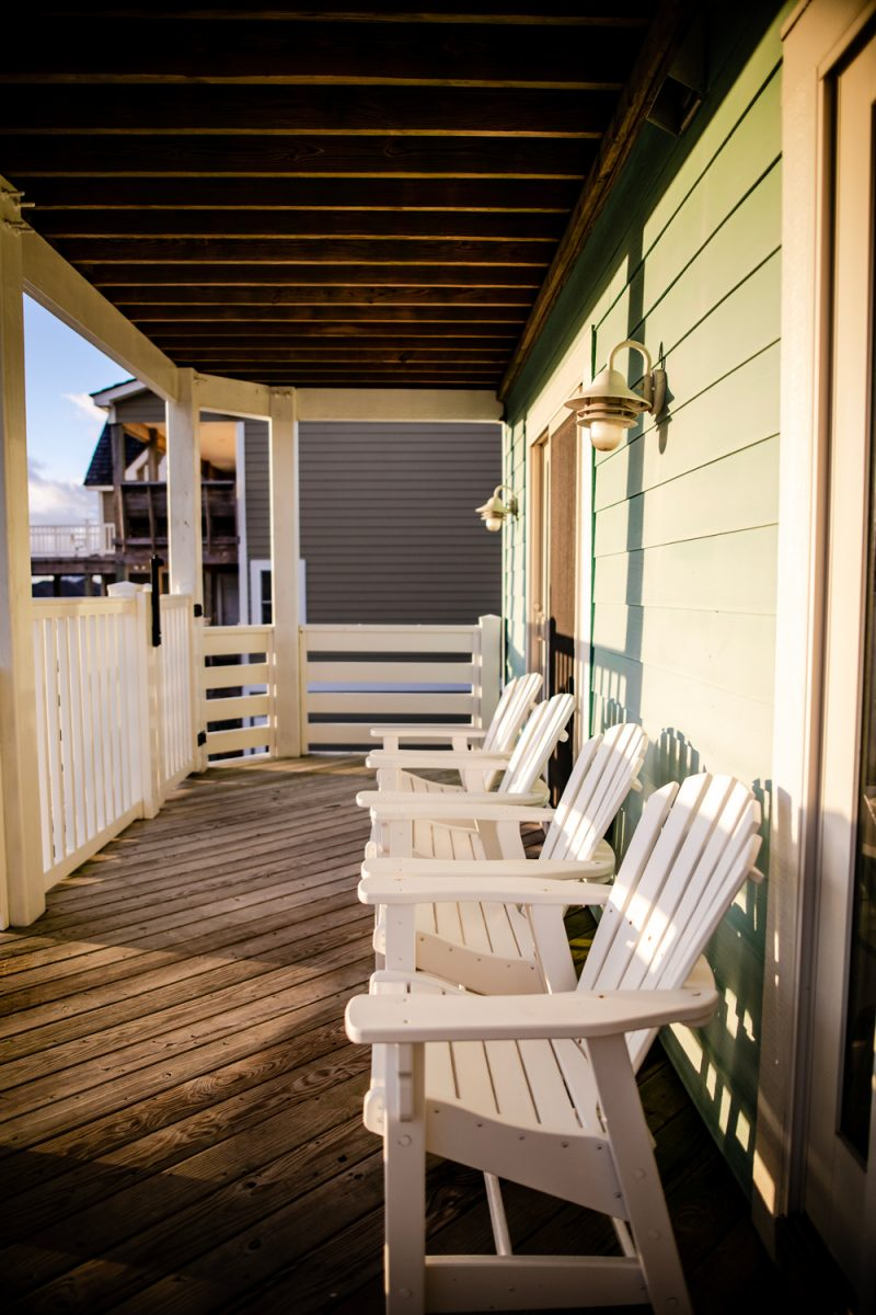 Where to Stay in the Outer Banks | Things to do in the Outer Banks by popular D.C. travel blogger, Alicia Tenise: image of some white outdoor lounge chairs.