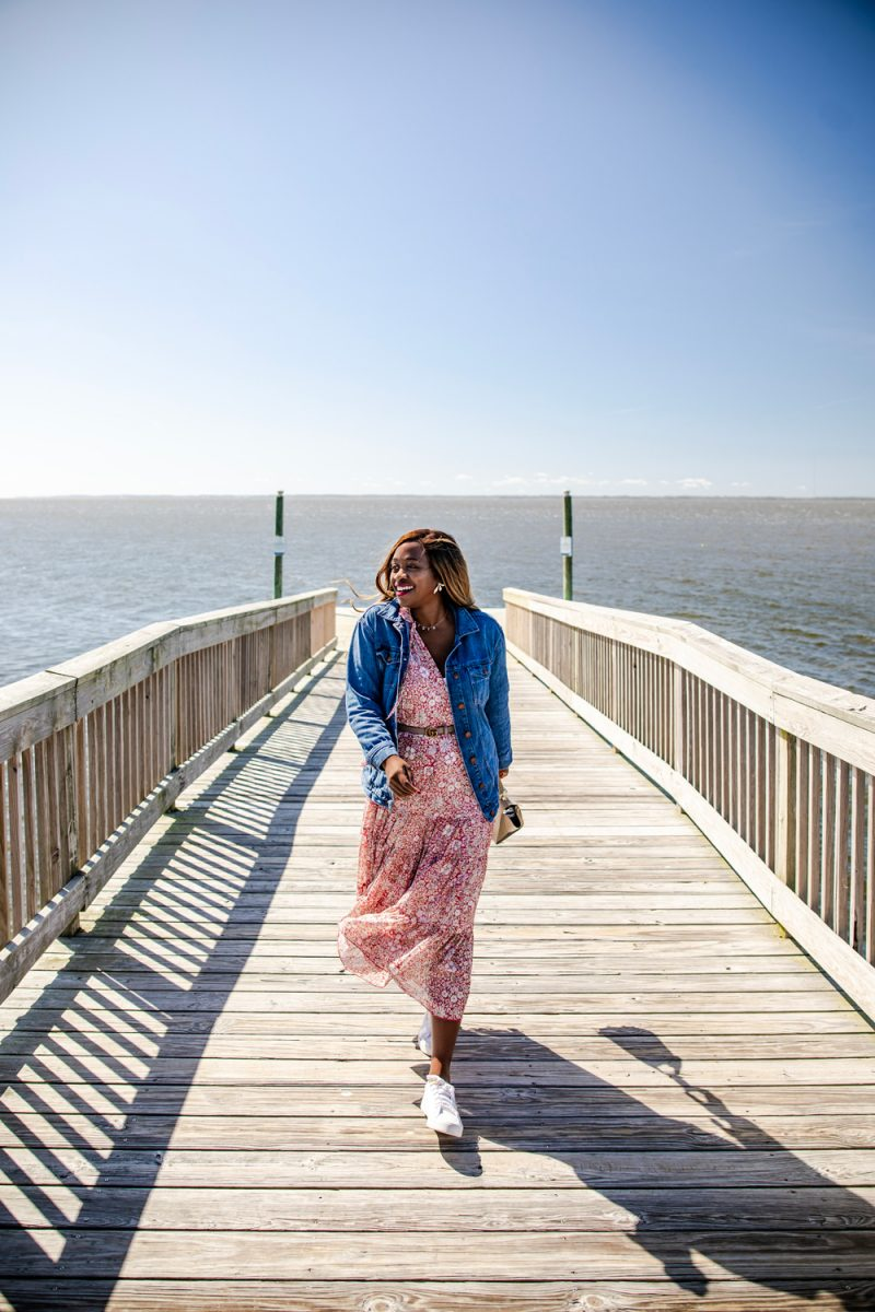 Duck North Carolina, Things to Do in the Outer Banks | Things to do in the Outer Banks by popular D.C. travel blogger, Alicia Tenise: image of Alicia Tenise walking on a boardwalk.