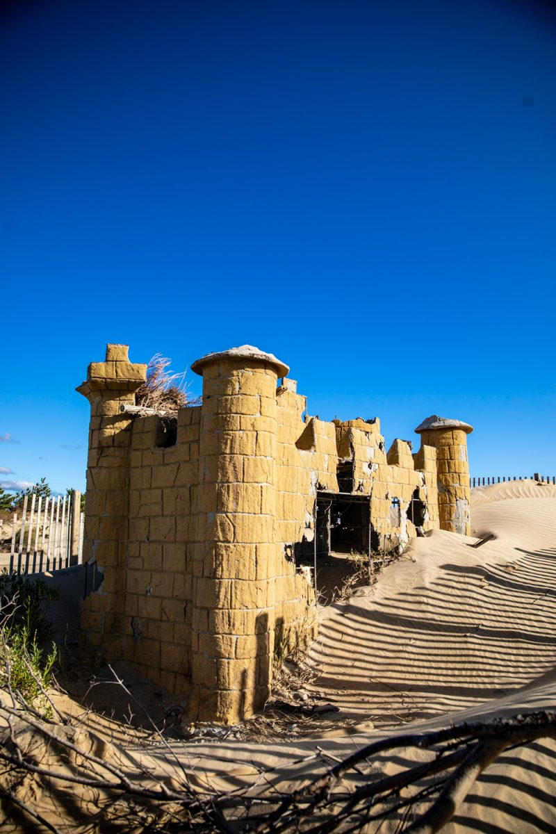 Jockey's Ridge State Park | Things to do in the Outer Banks by popular D.C. travel blogger, Alicia Tenise: image of a abandoned castle structure in Jockey's Ridge state park.