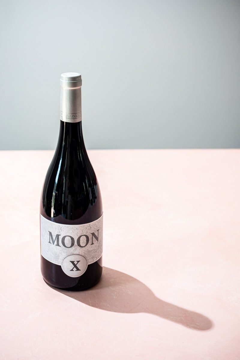 MoonX Black Pinot Noir | Trader Joe's Wines by popular D.C. lifestyle blogger, Alicia Tenise: image of Trader Joe's Moon wine.
